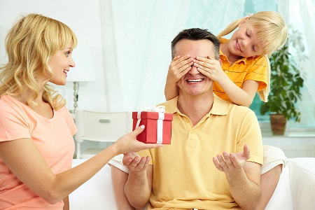 wife-and-daughter-family-gives-birthday-gift-for-dad