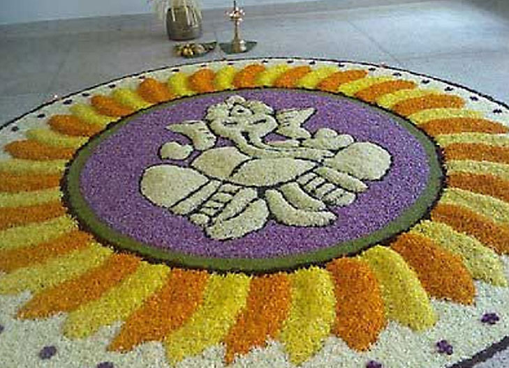 ganpati_rangoli_with_flowers-best-ganesh-rangoli-design-ganpati-bappa-morya