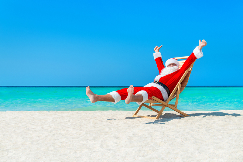 aussie-christmas-holiday-ideas-travel-summer-santa-sunlounger-wyza-com-au